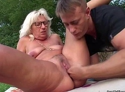 Granny fucked open-air